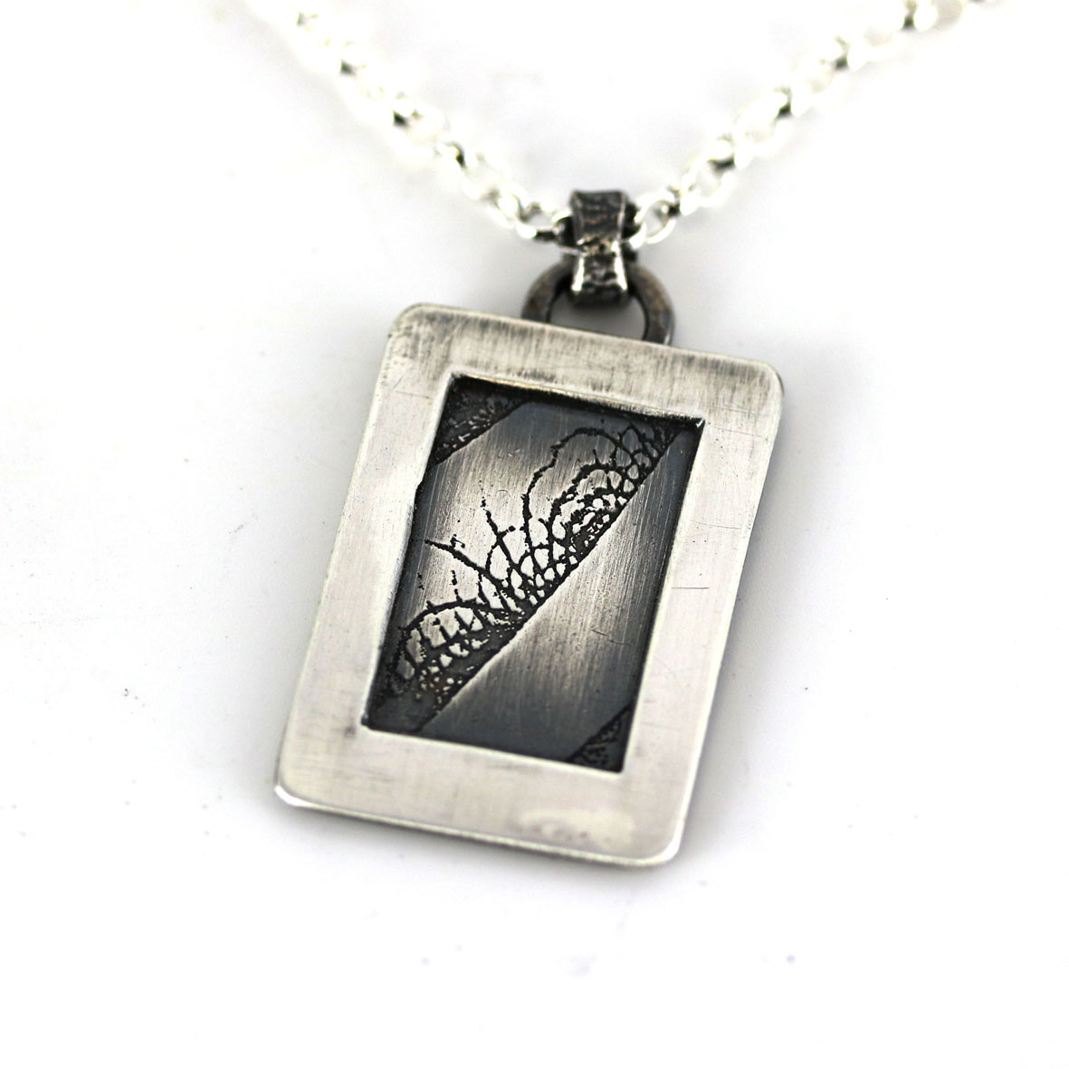 Etched silver pendant